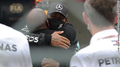 Hamilton celebrates his victory with his father Anthony.