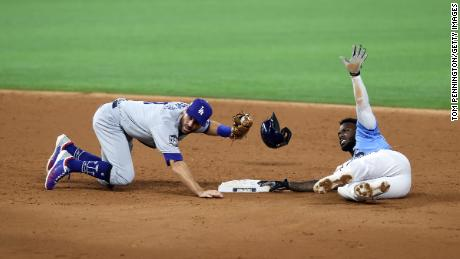 Chris Taylor of the Los Angeles Dodgers tags out Randy Arozarena of the Tampa Bay Rays during an attempt to steal second base in the third inning in Game 5 of the World Series at Globe Life Field.