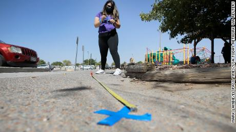 Audrey Rodriguez of the Bowling Family YMCA in Northeast El Paso prepares the venue for early voting by putting out social distancing and direction markers from the entrance into the parking lot.