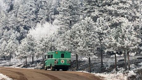 This October 23, 2020, photo released by the US Forest Service shows light snow at Division X of Cameron Peak Fire at the Rocky Mountain Park in Colorado.