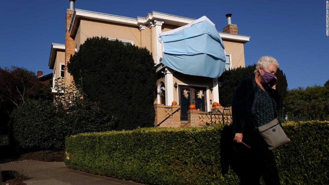 An oversized surgical mask is displayed on the front of a house in San Francisco. The homeowner put it there ahead of Halloween.