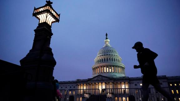 A jogger takes a early morning run at the Capitol on October 26.