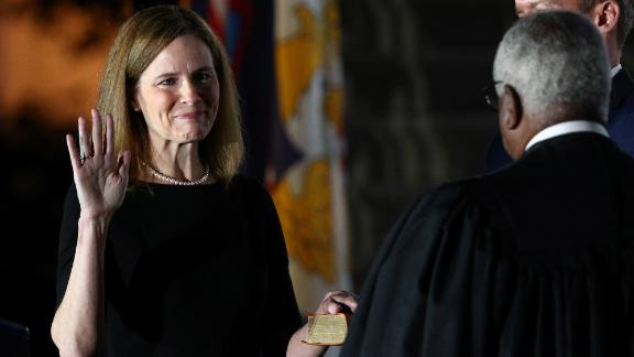 Barrett is sworn in as a Supreme Court justice during a White House ceremony on October 26.