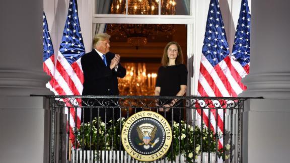 President Donald Trump applauds Barrett after she was sworn in on October 26.
