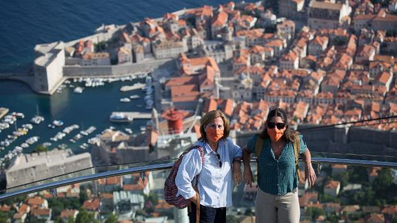 <strong>Dubrovnik, Croatia: </strong>Tourists in Dubrovnik in July 2020. Over the past couple of years, the city became increasingly packed with tourists. Then in March, Croatia closed its borders and the travelers stopped coming. International visitors began to return in the summer but it wasn't to last -- Covid numbers began to rise again and tourism declined once more.