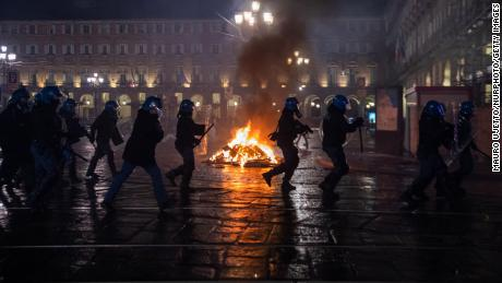 Protesters clash with police in northern Italy as anger mounts over Covid-19 restrictions