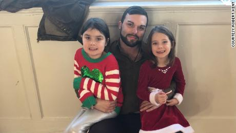 Robert Kent (center) of Warren, Rhode Island, single dad to daughters Ayla (left) and Bella  (right), oversees their online learning three days a week.
