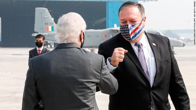 US Secretary of State Mike Pompeo (right) is greeted by US Ambassador to India Kenneth Juster upon his arrival at an airport in New Delhi on October 26, 2020.