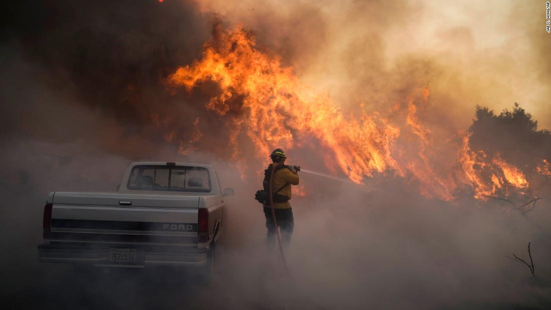 Firefighter Raymond Vasquez battles the Silverado Fire in Irvine on Monday, October 26.
