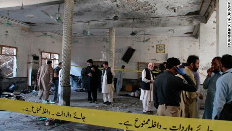 A powerful bomb blast ripped through the Islamic seminary on the outskirts of the northwest Pakistani city of Peshawar on Tuesday morning, killing some students and wounding dozens others, police and a hospital spokesman said.