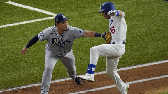 Tampa Bay Rays first baseman Ji-Man Choi tags out Los Angeles Dodgers