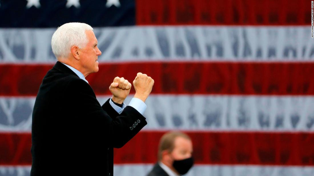 Vice President Mike Pence walks on stage for a campaign rally in Waterford, Michigan, on October 22.