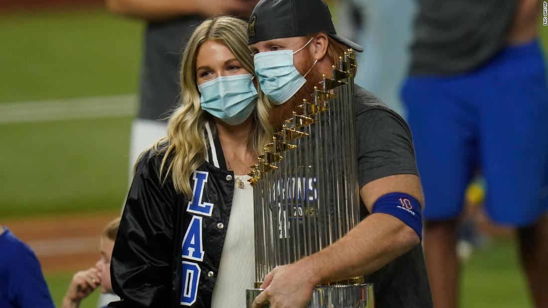 "Dodgers third baseman Justin Turner celebrates with the trophy. He had to be pulled in the middle of Game 6 <a href=""https://www.cnn.com/2020/10/28/sport/justin-turner-coronavirus-los-angeles-dodgers-world-series-spt-intl/index.html"" target=""_blank"">after testing positive for Covid-19.</a> He returned to the field for the postgame celebrations."