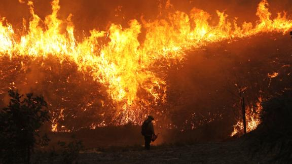 Firefighters conduct a backfire operation in Chino Hills on October 27.