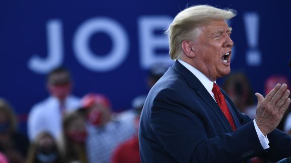 US President Donald Trump delivers remarks on the economy at an airport hanger on August 17, 2020 in Oshkosh, Wisconsin. (Photo by Brendan Smialowski / AFP) (Photo by BRENDAN SMIALOWSKI/AFP via Getty Images)