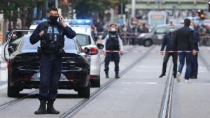 French policemen stand guard a street after a knife attack in Nice on October 29, 2020. - A man wielding a knife outside a church in the southern French city of Nice slit the throat of one person, leaving another dead and injured several others in an attack on Thursday morning, officials said. The suspected assailant was detained shortly afterwards, a police source said, while interior minister Gerald Darmanin said on Twitter that he had called a crisis meeting after the attack. (Photo by Valery HACHE / AFP) (Photo by VALERY HACHE/AFP via Getty Images)