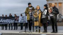 Bijan Ghaisar's mother, Kelly Ghaisar, speaks as her husband, James (right),  daughter, Negeen, and son-in-law, Kouros Emami (left), stand by her during a vigil commemorating the second anniversary of Bijan's death at the Lincoln Memorial on November 17, 2019.