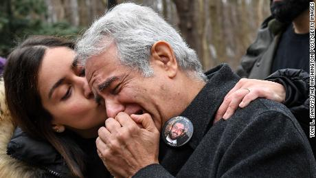 Negeen Ghaisar, left, comforts her father, James Ghaiser, after they tried to talk to someone to at the United States Park Police George Washington Memorial Parkway Station about the death of Bijan Ghaisar on Sunday, December 24, 2017.