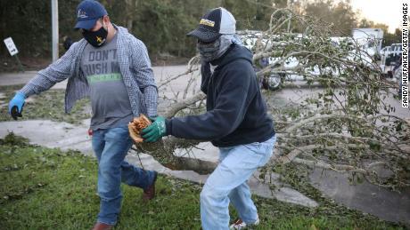 Workers clear debris from Hurricane Zeta Thursday at St. Bernard Middle School in St. Bernard, Louisiana.