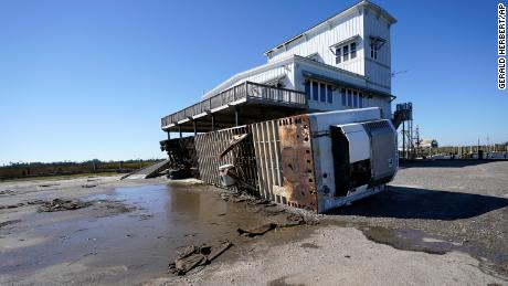A tractor trailer is seen overturned Thursday in Lakeshore, Mississippi, in the aftermath of Hurricane Zeta.