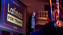 In this September 14, 2020 photo, President Donald Trump arrives for a Latinos for Trump Coalition roundtable at Arizona Grand Resort & Spa in Phoenix.