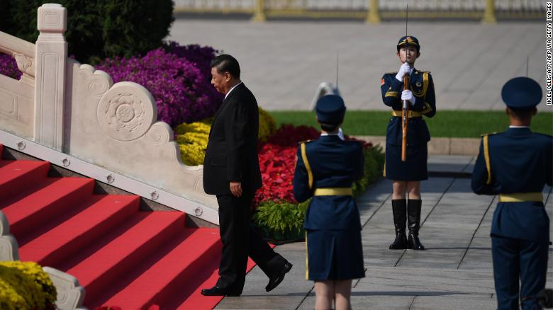 Chinese President Xi Jinping walks to the Monument to the Peoples Heroes during a wreath laying ceremony to honour deceased national heroes on Martyrs Day in Beijings Tiananmen Square on September 30.