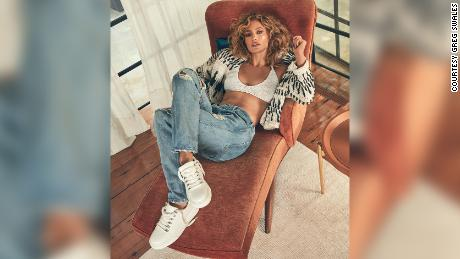 Jennifer Lopez wearing sneakers from the new reimagined JLO Jennifer Lopez fall collection for DSW.