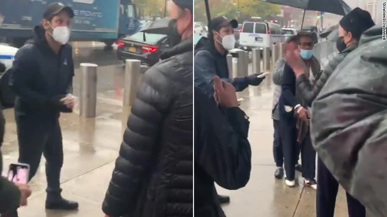 Actor Paul Rudd hands out cookies to voters waiting in the rain to cast their ballots