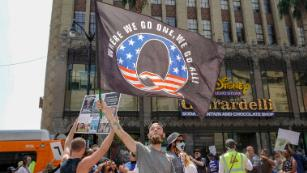 How QAnon's lies are hijacking the national conversation