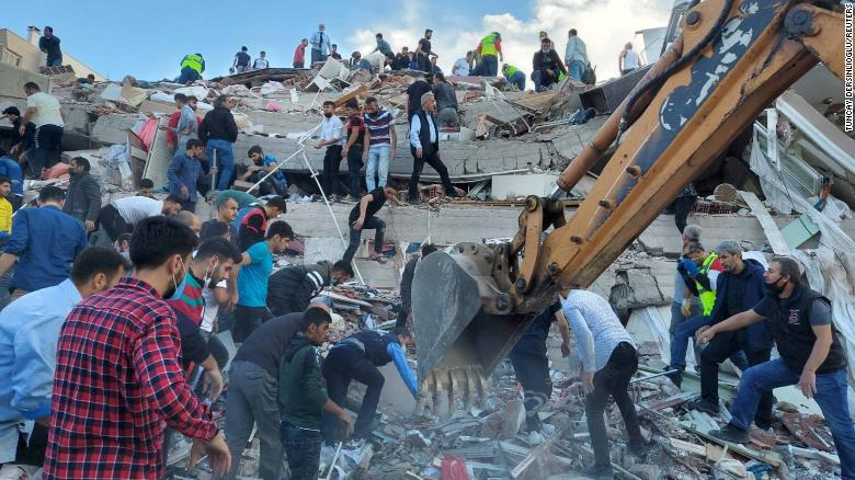 People search for survivors at a collapsed building in the coastal province of Izmir on Friday.