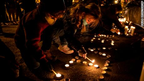 Children light candles Friday at a vigil for Kevin Peterson Jr. in Vancouver, Washington.