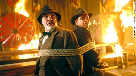 "Sean Connery, left, and Harrison Ford are pictured in 1989 in a scene from ""Indiana Jones and the Last Crusade."""