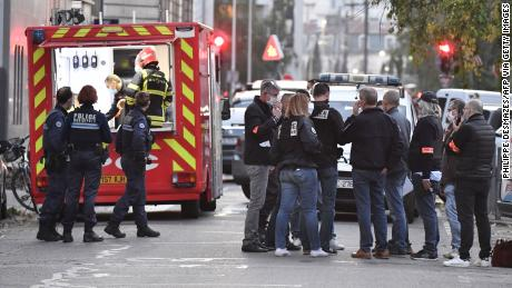Security and emergency personnel respond to the shooting in Lyon on Saturday.