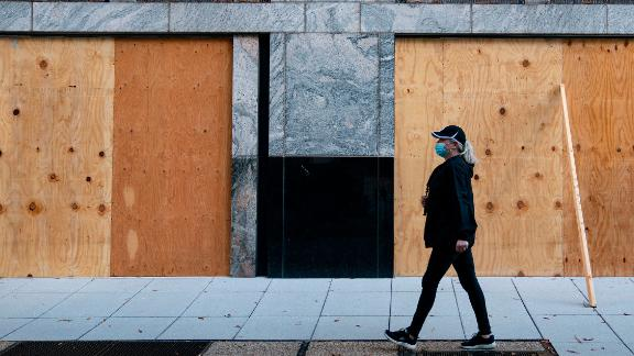 Wooden boards protect a Starbucks location near the White House on October 31, 2020 in Washington, DC. Many Washington businesses are boarding up windows in preparation for possible election related violence. - Violence erupted on January 20, 2017, in Washington, DC, as protesters damaged storefronts, and threw rocks and bricks at police officers during the inauguration of US President Donald Trump. (Photo by Alex Edelman / AFP) (Photo by ALEX EDELMAN/AFP via Getty Images)