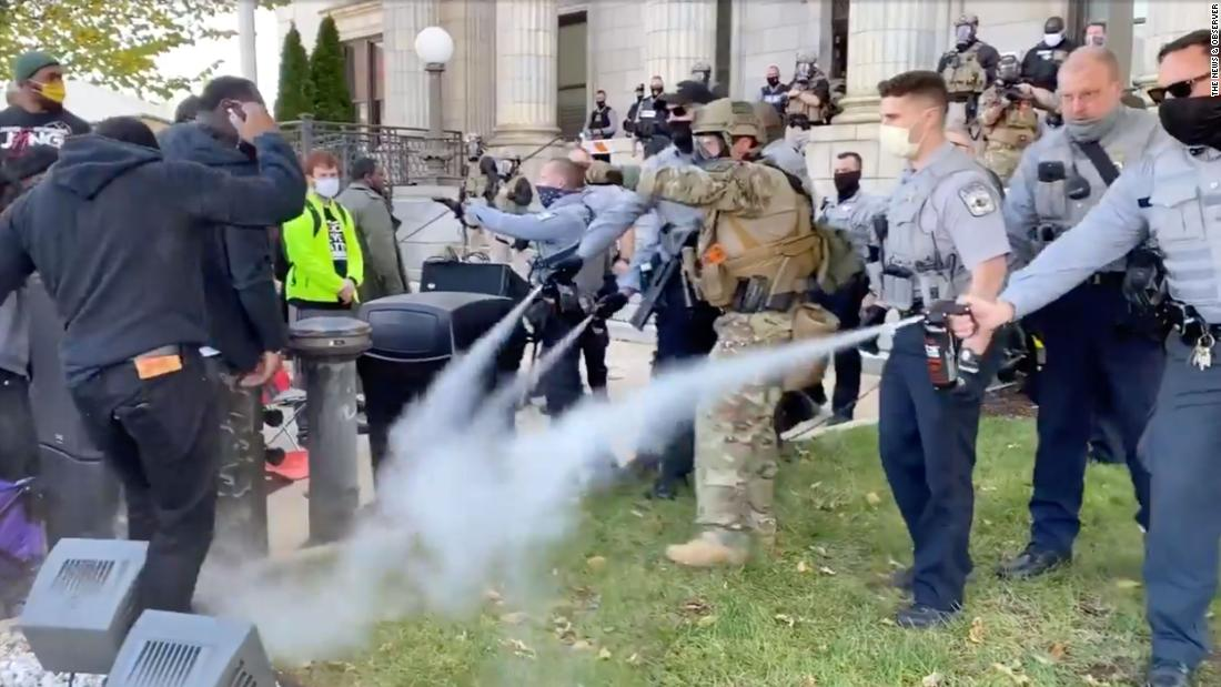 Police use pepper spray to break up North Carolina march to polling place