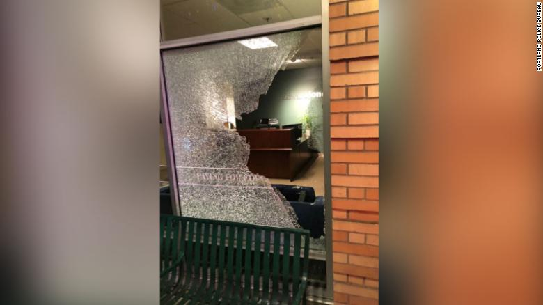 Police declared a riot after people damaged businesses in the city.