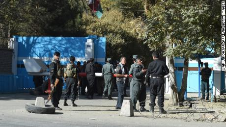 Policemen stand guard at an entrance gate to Kabul University on Monday.