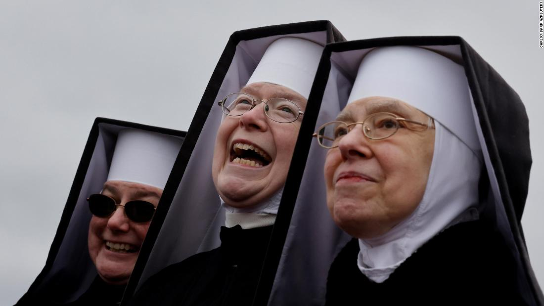 Nuns react as Trump campaigns in Waterford Township on October 30.