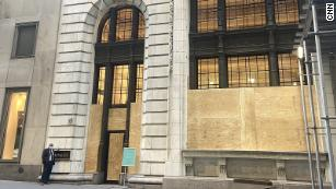 A Tiffany store boarded up in New York. Tiffany and other retailers are bracing for election-related unrest.