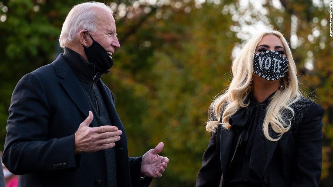 Biden talks with singer Lady Gaga before a drive-in rally in Pittsburgh on November 2.