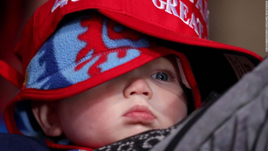 "A bundled-up baby wears a ""Make America Great Again"" hat at Trump's rally in Kenosha, Wisconsin, on November 2."