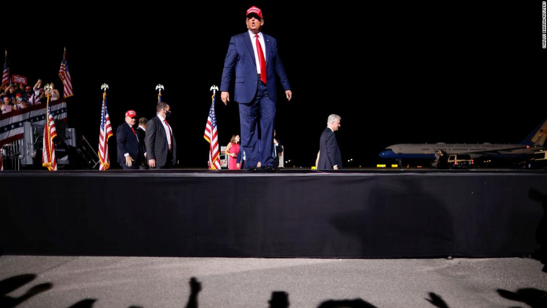 Trump arrives at an airport rally in Opa-Locka, Florida, on Monday, November 2.