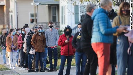 Voters wait in line to cast ballots in the presidential election on November 2, 2020 in Cedar Rapids, Iowa.