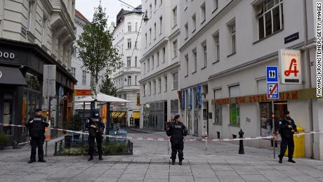 Police stand guard in Vienna city center Tuesday, a day after the attack.