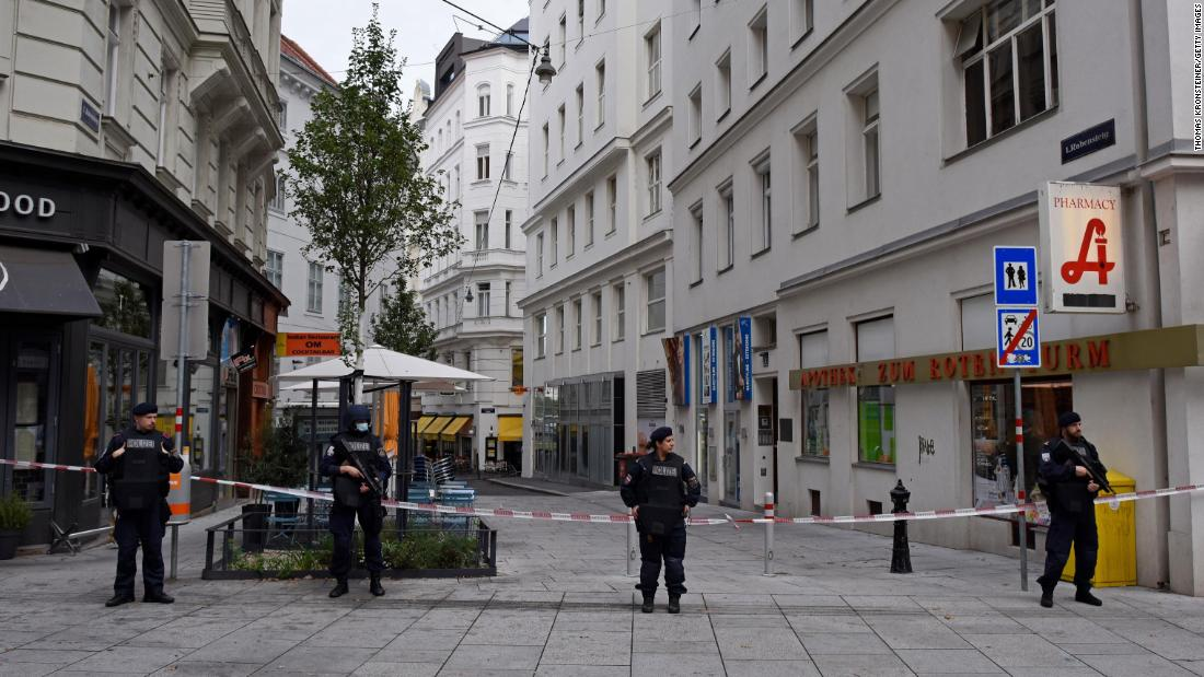 Police stand guard in Vienna's city center Tuesday, a day after the gun attack.