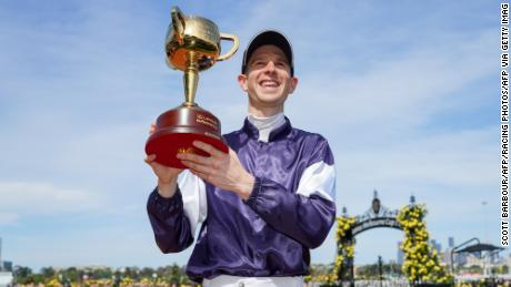 Jye McNeil celebrating after winning the Melbourne Cup at Flemington Racecourse.