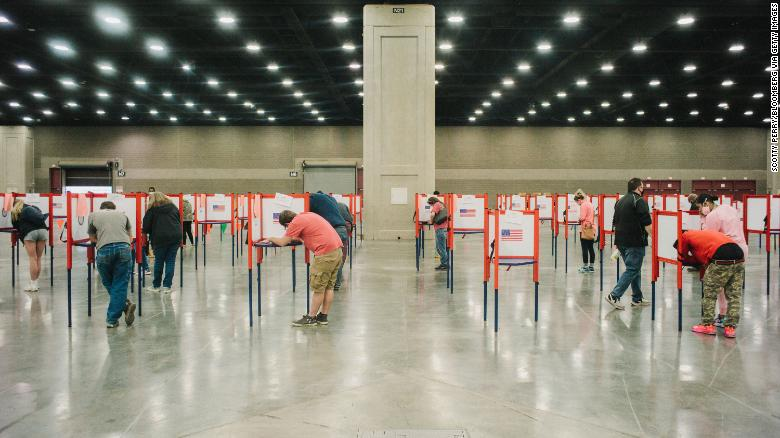 Election workers risked their health during pandemic. Now dozens are self-quarantining.