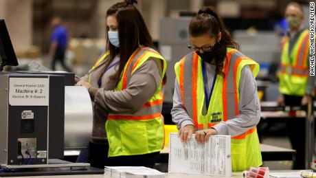Workers whittle down piles of uncounted ballots in key states