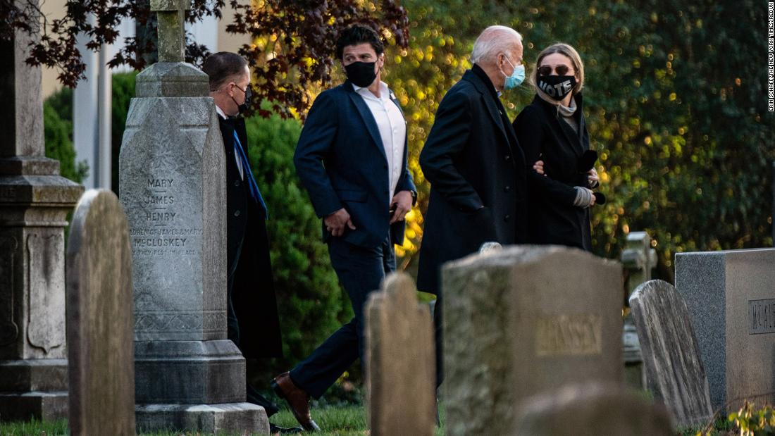 Democratic presidential nominee Joe Biden, walking arm in arm with his granddaughter Finnegan Biden, visits the grave of his son Beau early on Election Day.