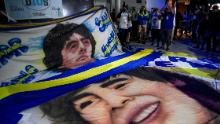 Maradona fans gather outside the hospital where he underwent brain surgery for a blood clot.